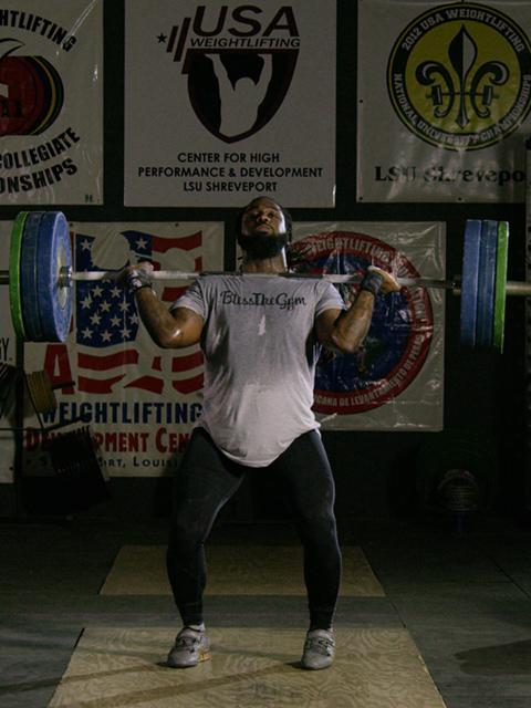 Kendrick Farris lifting weights