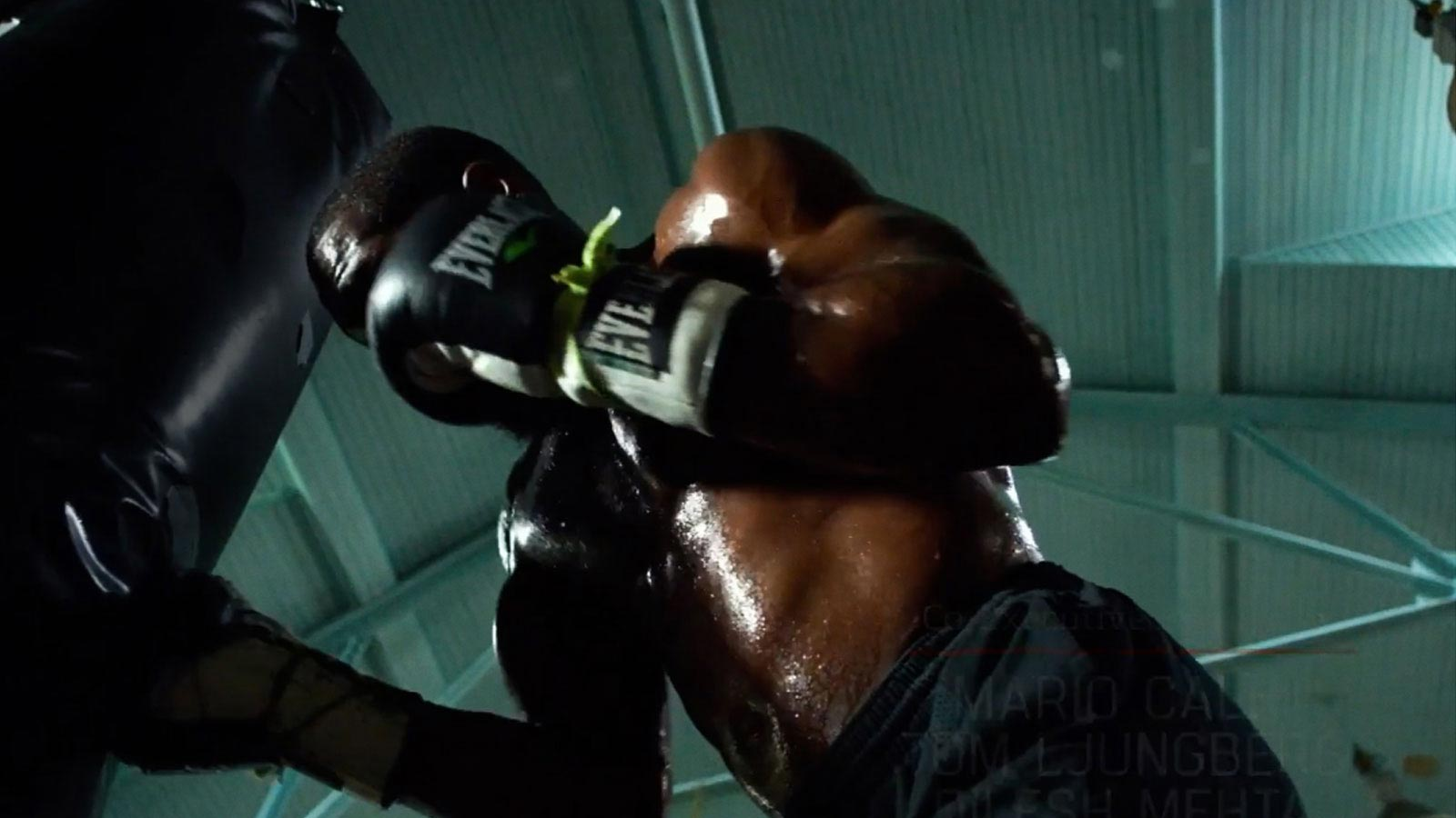 Still image from the movie showing a boxer punching a punching bag